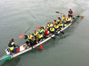 Kingsley Competing for charity in a dragonboat race